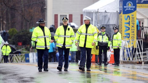 <p>               Massachusetts State Police walk the starting area of the 123rd Boston Marathon on Monday, April 15, 2019, in Hopkinton, Mass. (AP Photo/Stew Milne)             </p>