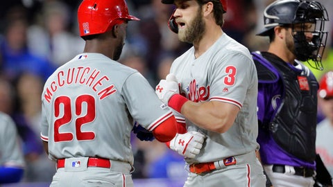 <p>               Philadelphia Phillies' Bryce Harper (3) celebrates his three-run home run that also scored teammate Andrew McCutchen (22) and Cesar Hernandez in the seventh inning of a baseball game against the Colorado Rockies in Denver, Saturday, April 20, 2019. (AP Photo/Joe Mahoney)             </p>