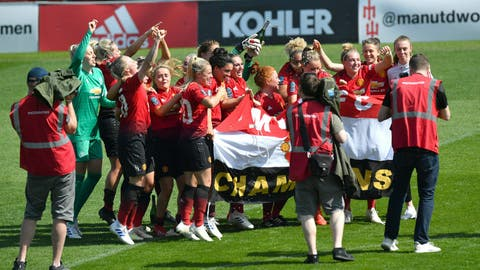 <p>               Manchester United players celebrates after the final whistle of the FA Women's Championship soccer match between Manchester United and Crystal Palace at Leigh Sports Village, Manchester, England. Saturday April 20, 2019. (Anthony Devlin/PA via AP)             </p>