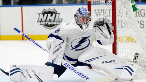 """<p>               File-This March 23, 2019, file photo shows Tampa Bay Lightning goaltender Andrei Vasilevskiy (88) deflecting a shot with his glove in the second period of an NHL hockey game against the St. Louis Blues, in St. Louis. Vasilevsky is in a tight race for the Vezina Trophy, given to the goaltender who is """"adjudged to be the best at this position"""". He is battling Ben Bishop (Dallas), Darcy Kuemper (Arizona), Carey Price (Montreal) Pekka Rinne (Nashville) for the trophy. (AP Photo/Tom Gannam, File)             </p>"""