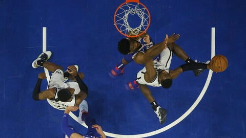 <p>               Brooklyn Nets' Caris LeVert, right, goes up for the shot against Philadelphia 76ers' Joel Embiid, center right, of Cameroon, during the first half in Game 5 of a first-round NBA basketball playoff series, Tuesday, April 23, 2019, in Philadelphia. (AP Photo/Chris Szagola)             </p>