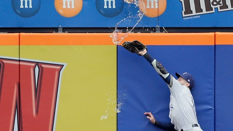 <p>               A fan spills beer on Milwaukee Brewers left fielder Ryan Braun as he tries but fails to grab a triple hit by New York Mets' Pete Alonso during the first inning of the MLB baseball game at Citi Field, Sunday, April 28, 2019, in New York. (AP Photo/Seth Wenig)             </p>