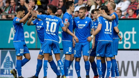 <p>               Hoffenheim's scorer Andrej Kramaric, 3rd from right, celebrates after scoring the opening goal during the Bundesliga soccer match between FC Augsburg and TSG Hoffenheim in Augsburg, Germany, Sunday, April 7, 2019. (Matthias Balk/dpa via AP)             </p>