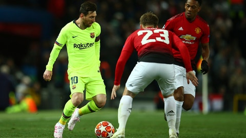 <p>               Barcelona's Lionel Messi, left, challenges with Manchester United's Luke Shaw during the Champions League quarterfinal, first leg, soccer match between Manchester United and FC Barcelona at Old Trafford stadium in Manchester, England, Wednesday, April 10, 2019. (AP Photo/Dave Thompson)             </p>