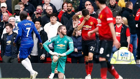 <p>               Manchester United goalkeeper David de Gea sits dejected after Chelsea's Marcos Alonso, not pictured, scores his side's first goal of the game during their English Premier League soccer match at Old Trafford, Manchester, England, Sunday, April 28, 2019. (Martin Rickett/PA via AP)             </p>
