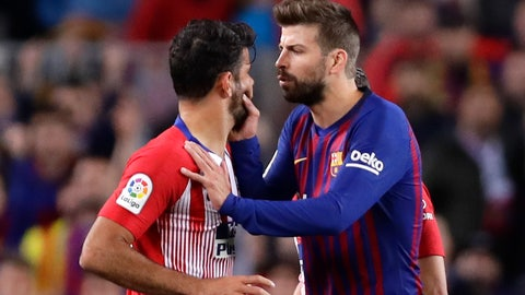 <p>               Barcelona's Gerard Pique, right, talks to Atletico forward Diego Costa as he tries to calm him after he was sent off with a red card for insulting referee Jesus Gil Manzano during a Spanish La Liga soccer match between FC Barcelona and Atletico Madrid at the Camp Nou stadium in Barcelona, Spain, Saturday April 6, 2019. (AP Photo/Manu Fernandez)             </p>