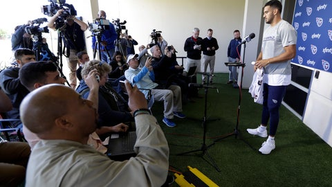 <p>               Tennessee Titans quarterback Marcus Mariota answers questions during a news conference Monday, April 15, 2019, in Nashville, Tenn. The Titans are trying to figure out how to improve after three straight 9-7 seasons as the team begins their offseason program. (AP Photo/Mark Humphrey)             </p>