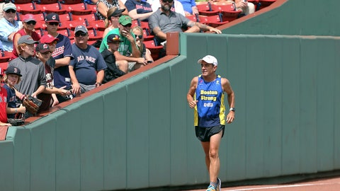 <p>               FILE - In this Aug. 23, 2018 file photo, Dave McGillivray, race director of the Boston Marathon, runs past fans inside Fenway Park, as he commemorates the last leg of his 80-day run in 1978 to benefit the Jimmy Fund, before a baseball game in Boston. A few months later, McGillivray underwent triple bypass surgery after suffering chest discomfort and difficulty breathing while running. He is cautioning people thinking of running a marathon to talk with their doctors before hitting the road, especially if they have coronary artery disease or a family history of it. (AP Photo/Elise Amendola, File)             </p>