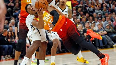 <p>               Utah Jazz guard Donovan Mitchell (45) shoots as Denver Nuggets forward Paul Millsap, rear, defends during the second half of an NBA basketball game Tuesday, April 9, 2019, in Salt Lake City. (AP Photo/Rick Bowmer)             </p>