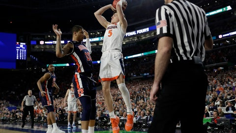 <p>               FILE - In this April 6, 2019, file photo, Virginia's Kyle Guy (5) takes a shot as Auburn's Samir Doughty (10) was called for a foul during the second half in the semifinals of the Final Four NCAA college basketball tournament, in Minneapolis. Guy sank all three free throws and Virginia defeated Auburn 63-62. (AP Photo/David J. Phillip, File)             </p>