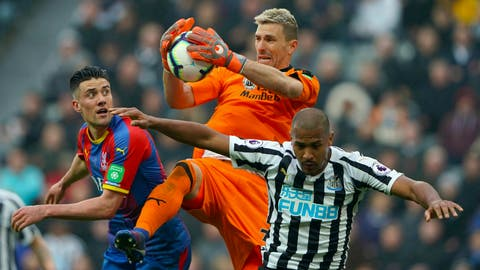 <p>               Crystal Palace goalkeeper Vicente Guaita makes a save during the English Premier League soccer match against Newcastle United at St James' Park, Newcastle, England, Saturday April 6, 2019. (Owen Humphreys/PA via AP)             </p>
