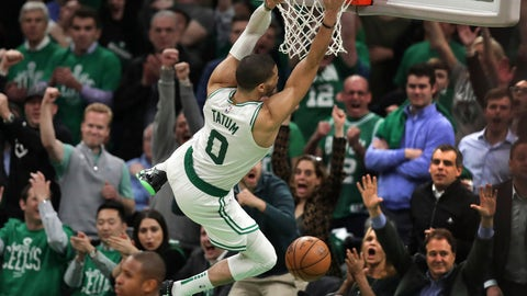 <p>               Boston Celtics forward Jayson Tatum (0) hangs on the rim after slamming a dunk against the Indiana Pacers in the final minute of the fourth quarter of Game 2 of an NBA basketball first-round playoff series, Wednesday, April 17, 2019, in Boston. The Celtics won 99-91. (AP Photo/Charles Krupa)             </p>