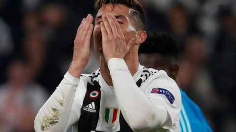 <p>               Juventus' Cristiano Ronaldo reacts after missing a scoring chance during the Champions League quarter final, second leg soccer match between Juventus and Ajax, at the Allianz stadium in Turin, Italy, Tuesday, April 16, 2019. (AP Photo/Antonio Calanni)             </p>