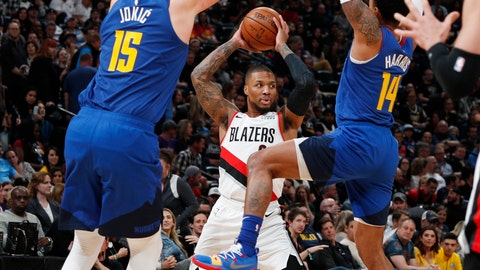 <p>               Portland Trail Blazers guard Damian Lillard, rear, looks to pass the ball as Denver Nuggets center Nikola Jokic, left, and guard Gary Harris defend during the second half of an NBA basketball game Friday, April 5, 2019, in Denver. The Nuggets won 119-110. (AP Photo/David Zalubowski)             </p>