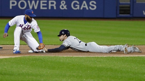 <p>               Milwaukee Brewers' Christian Yelich, right, beats the tag by New York Mets shortstop Amed Rosario to steal second base during the first inning of a baseball game Friday, April 26, 2019, in New York. (AP Photo/Frank Franklin II)             </p>