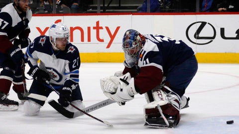 <p>               Winnipeg Jets left wing Nikolaj Ehlers (27) scores on Colorado Avalanche goaltender Philipp Grubauer (31) during the first period of an NHL hockey game in Denver, Thursday, April 4, 2019. (AP Photo/Joe Mahoney)             </p>