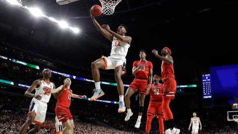 <p>               Virginia guard De'Andre Hunter (12) drives to the basket over Texas Tech's Matt Mooney (13), Jarrett Culver (23) and Tariq Owens, right, during the first half in the championship of the Final Four NCAA college basketball tournament, Monday, April 8, 2019, in Minneapolis. (AP Photo/Jeff Roberson)             </p>
