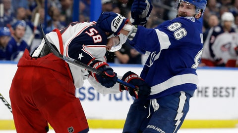 <p>               Tampa Bay Lightning right wing Nikita Kucherov (86) grabs Columbus Blue Jackets defenseman David Savard (58) during the second period of Game 2 of an NHL Eastern Conference first-round hockey playoff series Friday, April 12, 2019, in Tampa, Fla. (AP Photo/Chris O'Meara)             </p>