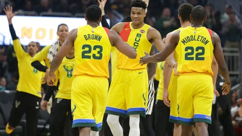 <p>               Milwaukee Bucks' Giannis Antetokounmpo, middle, gives high-fives to Sterling Brown (23) and Khris Middleton (22) during the first half of an NBA basketball game Sunday, April 7, 2019, in Milwaukee. (AP Photo/Aaron Gash)             </p>