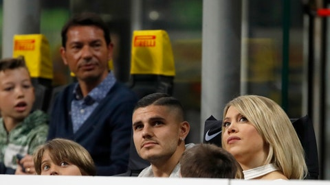 <p>               Inter Milan's Mauro Icardi and his wife Wanda Nardi attend a Serie A soccer match between Inter Milan and Lazio, in Milan, Italy, Sunday, March 31, 2019. (AP Photo/Antonio Calanni)             </p>