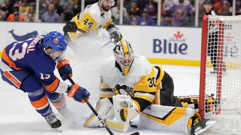 <p>               New York Islanders center Mathew Barzal, left, gets a pass by Pittsburgh Penguins goaltender Matt Murray (30) before left wing Anthony Beauvillier scored a goal for the Islanders during the second period of Game 2 of an NHL hockey first-round playoff series Friday, April 12, 2019, in Uniondale, N.Y. (AP Photo/Julio Cortez)             </p>