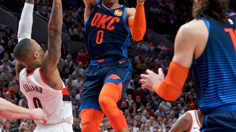 <p>               Oklahoma City Thunder guard Russell Westbrook, center, passes the ball away from Portland Trail Blazers guard Damian Lillard during the first half of Game 5 of an NBA basketball first-round playoff series, Tuesday, April 23, 2019, in Portland, Ore. (AP Photo/Craig Mitchelldyer)             </p>