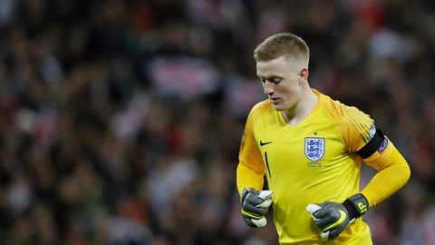 <p>               England goalkeeper Jordan Pickford runs during the Euro 2020 group A qualifying soccer match between England and the Czech Republic at Wembley stadium in London, Friday March 22, 2019. (AP Photo/Tim Ireland)             </p>