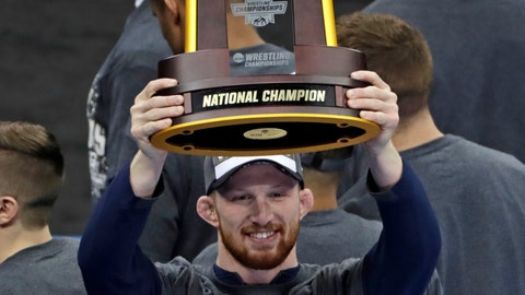 <p>               Penn State's Bo Nickal, who won his 197-pound match against Ohio State's Kollin Moore in the finals of the NCAA wrestling championships, holds the team championship trophy that his school won for a record eighth time in nine years, Saturday, March 23, 2019, in Pittsburgh. (AP Photo/Gene J. Puskar)             </p>