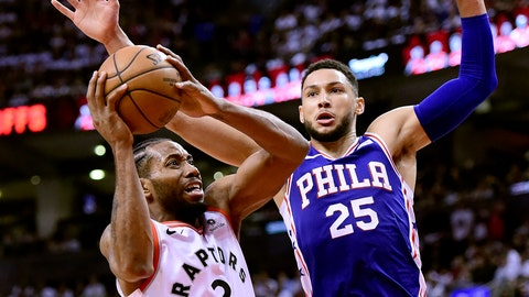 <p>               Toronto Raptors forward Kawhi Leonard (2) looks for the shot as Philadelphia 76ers guard Ben Simmons (25) defends during the second half of Game 1 of a second-round NBA basketball playoff series, in Toronto, Saturday, April 27, 2019. (Frank Gunn/The Canadian Press via AP)             </p>