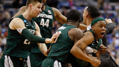 <p>               Michigan State guard Cassius Winston, right, celebrates with teammates Matt McQuaid (20), Nick Ward (44) and Gabe Brown (13) after defeating Duke in an NCAA men's East Regional final college basketball game in Washington, Sunday, March 31, 2019. (AP Photo/Patrick Semansky)             </p>