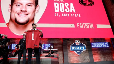 <p>               Ohio State defensive end Nick Bosa shows off his new jersey after the San Francisco 49ers selected Bosa in the first round at the NFL football draft, Thursday, April 25, 2019, in Nashville, Tenn. (AP Photo/Mark Humphrey)             </p>