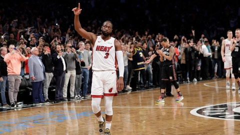 <p>               Miami Heat guard Dwyane Wade (3) acknowledges the crowd's cheers after playing in the final NBA basketball game of his career, against the Brooklyn Nets on Wednesday, April 10, 2019, in New York. (AP Photo/Kathy Willens)             </p>