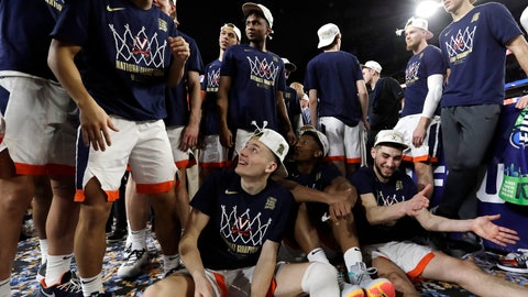 <p>               Virginia players celebrate after the championship game against Texas Tech in the Final Four NCAA college basketball tournament, Monday, April 8, 2019, in Minneapolis. Virginia won 85-77 in overtime. (AP Photo/David J. Phillip)             </p>