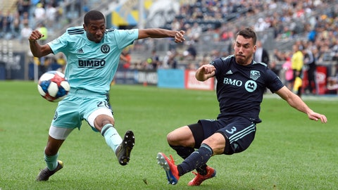 <p>               Montreal Impact's Daniel Lovitz, right, takes a shot past the reach of Philadelphia Union's Ray Gaddis during the second half of an MLS soccer match, Saturday, April 20, 2019, in Chester, Pa. The Union won 3-0. (AP Photo/Derik Hamilton)             </p>