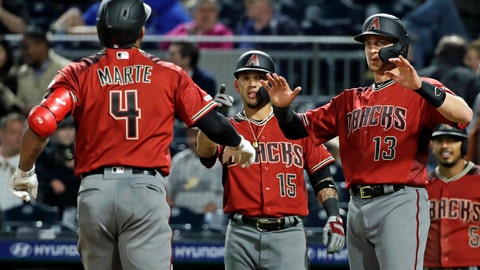 <p>               Arizona Diamondbacks' Ketel Marte (4) is greeted by Nick Ahmed (13) and Ildemaro Vargas (15) who were on base for his three-run home run off Pittsburgh Pirates relief pitcher Steven Brault in the eighth inning of a baseball game in Pittsburgh, Wednesday, April 24, 2019. It was Marte's second home run of the game. (AP Photo/Gene J. Puskar)             </p>