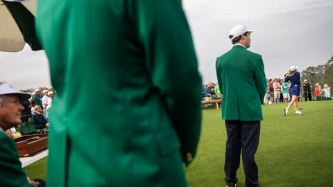 <p>               Marta Perez, of Spain, right, tees off the first hole as members of the Augusta National Golf Club, wearing the traditional green jackets, look on during the final round of the Augusta National Women's Amateur golf tournament in Augusta, Ga., Saturday, April 6, 2019. (AP Photo/David Goldman)             </p>