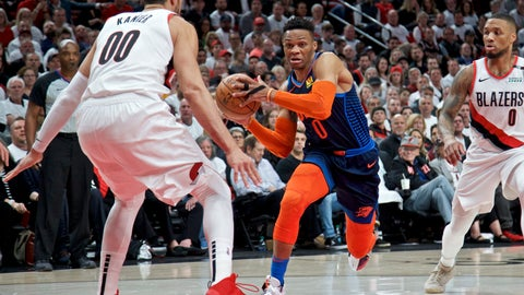 <p>               Oklahoma City Thunder guard Russell Westbrook, center, drives to the basket past Portland Trail Blazers guard Damian Lillard, right, and center Enes Kanter, left, during the first half of Game 5 of an NBA basketball first-round playoff series, Tuesday, April 23, 2019, in Portland, Ore. (AP Photo/Craig Mitchelldyer)             </p>