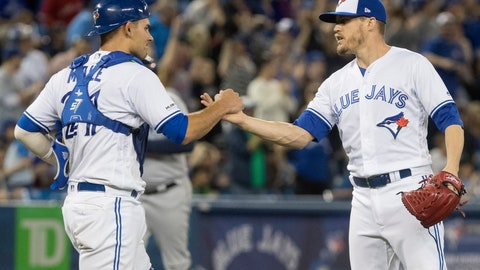<p>               Toronto Blue Jays catcher Luke Maile congratulates pitcher Ken Giles after the Jays defeated the Tampa Bay Rays in a baseball game in Toronto on Saturday, April 13, 2019. (Fred Thornhill/The Canadian Press via AP)             </p>