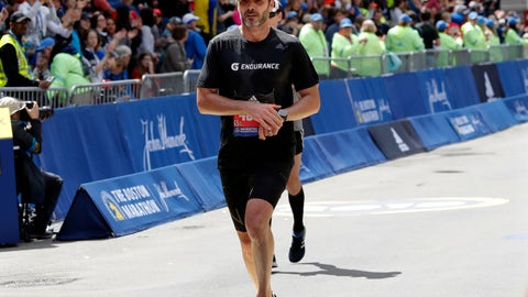 <p>               NASCAR driver Jimmie Johnson, of Charlotte, N.C., finishes the 123rd Boston Marathon on Monday, April 15, 2019, in Boston. (AP Photo/Winslow Townson)             </p>