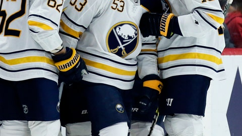 <p>               Buffalo Sabres left wing Jeff Skinner (53) smiles while celebrating his second period goal against the Detroit Red Wings with defenseman Brandon Montour (62) and defenseman Jake McCabe (19) during an NHL hockey game Saturday, April 6, 2019, in Detroit. (AP Photo/Duane Burleson)             </p>