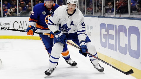 <p>               Toronto Maple Leafs' John Tavares (91) looks to pass away from New York Islanders' Johnny Boychuk (55) during the first period of an NHL hockey game Monday, April 1, 2019, in Uniondale, N.Y. (AP Photo/Frank Franklin II)             </p>