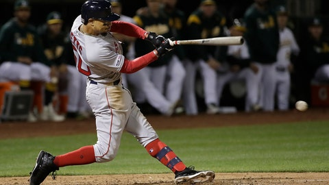 <p>               Boston Red Sox's Mookie Betts hits a two-run double against the Oakland Athletics during the ninth inning of a baseball game in Oakland, Calif., Wednesday, April 3, 2019. (AP Photo/Jeff Chiu)             </p>