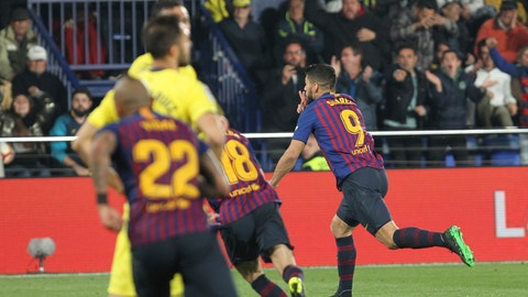<p>               Barcelona forward Luis Suarez celebrates after scoring his side's fourth goal during the Spanish La Liga soccer match between Villarreal and FC Barcelona at the Ceramica stadium in Villarreal, Spain, Tuesday, April 2, 2019.(AP Photo/Alberto Saiz)             </p>