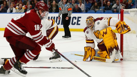 <p>               Massachusetts defenseman Cale Makar (16) looks to shoot on Minnesota-Duluth goalie Hunter Shepard (32) during the first period of the NCAA Frozen Four men's college hockey championship game Saturday, April 13, 2019, in Buffalo, N.Y. (AP Photo/Jeffrey T. Barnes)             </p>