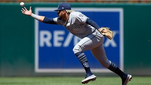 <p>               San Diego Padres shortstop Fernando Tatis Jr. can't get to a ball that went for a single by Washington Nationals' Brian Dozier during the first inning of a baseball game, Sunday, April 28, 2019, in Washington. (AP Photo/Nick Wass)             </p>