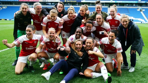 <p>               Arsenal players celebrate winning the FA Women's Super League at full time,  at the AMEX Stadium, Brighton, England, Sunday, April 28, 2019. Arsenal Women became English champion for the first time since 2012 on Sunday. The team beat Brighton 4-0 in front of a record crowd of 5,265 fans at the Amex Stadium to clinch the Women's Super League title. (Mark Kerton/PA via AP)             </p>