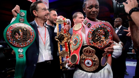 <p>               Claressa Shields holds her belts after defeating Christina Hammer by unanimous decision in the women's world middleweight championship boxing bout Saturday, April 13, 2019, in Atlantic City, N.J. (AP Photo/Julio Cortez)             </p>
