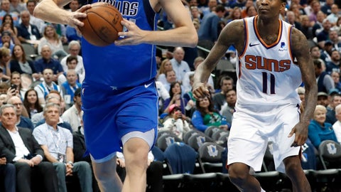 <p>               Dallas Mavericks forward Dirk Nowitzki (41) drives past Phoenix Suns guard Jamal Crawford (11) to the basket for a dunk during the second half of an NBA basketball game in Dallas, Tuesday, April 9, 2019. (AP Photo/Tony Gutierrez)             </p>