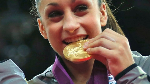 <p>               FILE - In this July 31, 2012, file photo, U.S. gymnast Jordyn Wieber bites her gold medal at the Artistic Gymnastics women's team final at the 2012 Summer Olympics, in London. Arkansas has picked Olympic gold medalist and former world all-around champion Jordyn Wieber as head coach of the Razorbacks' women's gymnastics team. Athletic director Hunter Yurachek announced the hiring Wednesday, April 14, 2019. (AP Photo/Matt Dunham, File)             </p>