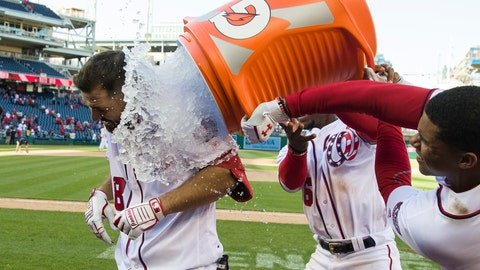 <p>               Washington Nationals' Jake Noll, left, gets doused by Victor Robles and Juan Soto, right, after a baseball game against the Philadelphia Phillies at Nationals Park, Wednesday, April 3, 2019, in Washington. Noll drew a walk to force in the winning run. The Nationals won 9-8. (AP Photo/Alex Brandon)             </p>